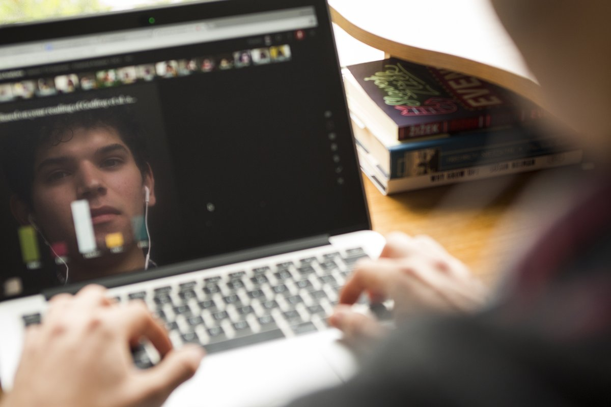 Student on ALF with face reflected in screen