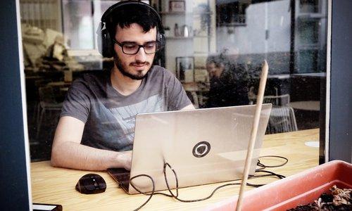 Student sitting a computer through window.jpg